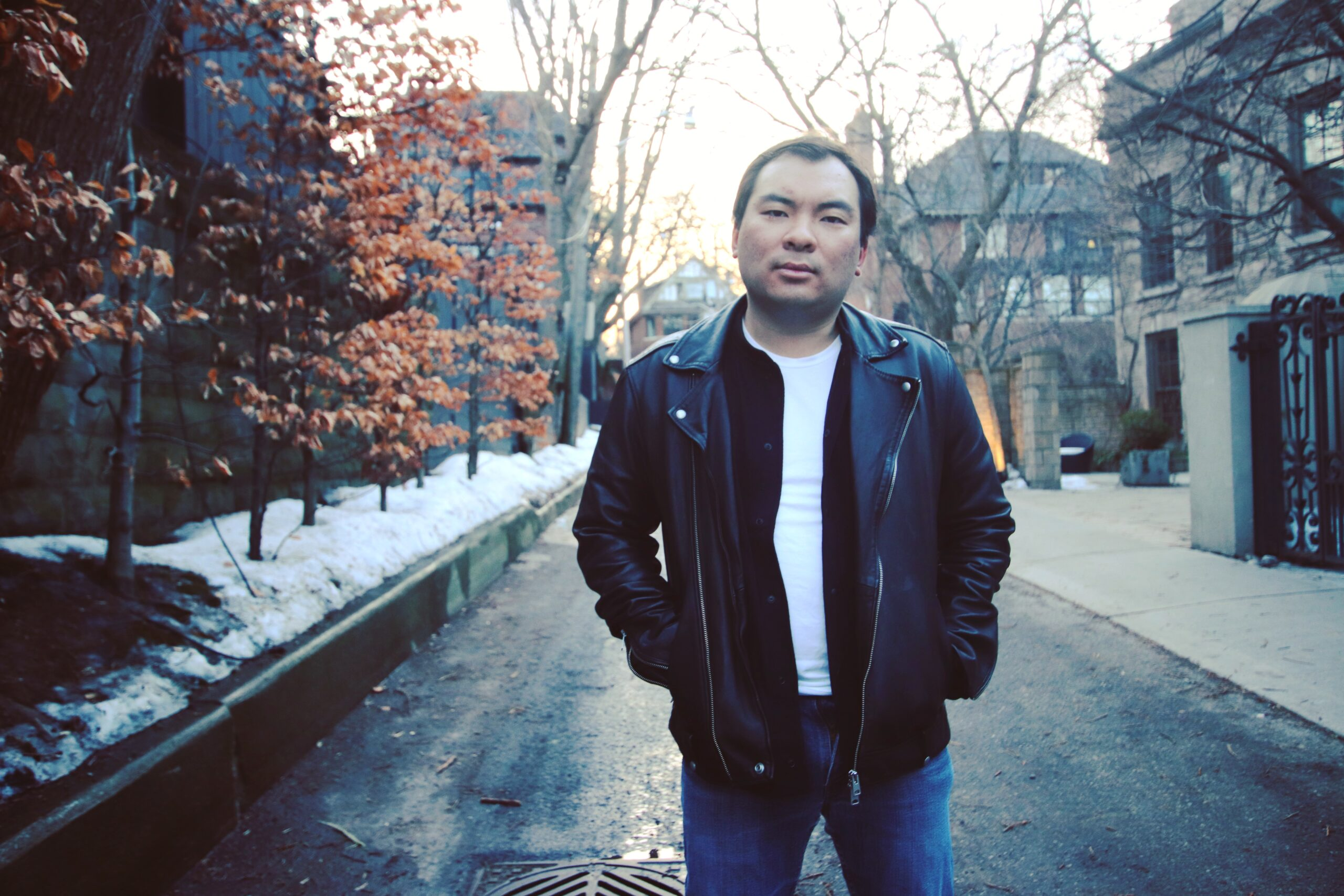 A photo of Aaron Jan standing outside on a fall day